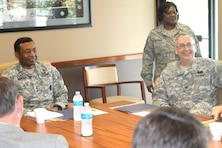 U.S. Army Corps of Engineers Commanding General Thomas P. Bostick and Northwestern Division Deputy Commander Col. Robert A. Tipton shares a laugh with teammates from the Kansas City District and stakeholders on May 25, 2012. Bostick was briefed on the Missouri River Levee System 471-460. U.S. Army Corps of Engineers photo by David S. Kolarik.