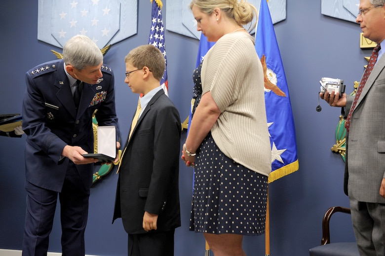 """Air Force Chief of Staff Gen. Norton Schwartz presents the Silver Star, posthumously awarded to Capt. Francis Gary Powers, to the captain's grandchildren, Francis Gary """"Trey"""" Powers III and Lindsey Barry, on June 15, 2012, in the Pentagon. Captain Powers was shot down over the Soviet Union on May 1, 1960, and received the decoration for the heroism he displayed while held prisoner by the Soviets.  He was released in 1962 but subsequently died in a 1977 helicopter crash. (U.S. Air Force photo/Senior Airman Christina Brownlow)"""