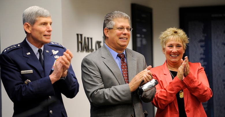 Air Force Chief of Staff Gen. Norton Schwartz celebrates with Gary Powers Jr. and Dee Powers, children of Capt. Francis Gary Powers, after Schwartz presented the captain's posthumous Silver Star to the family on June 15, 2012, in the Pentagon. Captain Powers was shot down over the Soviet Union on May 1, 1960, and received the decoration for the heroism he displayed while held prisoner by the Soviets.  He was released in 1962 but subsequently died in a 1977 helicopter crash. (U.S. Air Force photo/Scott M. Ash)