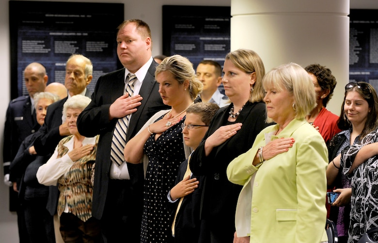 (From right) Suzie Schwartz, wife of Air Force Chief of Staff Gen. Norton Schwartz, and family members of Capt. Francis Gary Powers stand for the National Anthem during the posthumous presentation of the captain's Silver Star on June 15, 2012, in the Pentagon. Captain Powers was shot down over the Soviet Union on May 1, 1960, and received the decoration for the heroism he displayed while held prisoner by the Soviets. He was released in 1962 but subsequently died in a 1977 helicopter crash. (U.S. Air Force photo/Scott M. Ash)