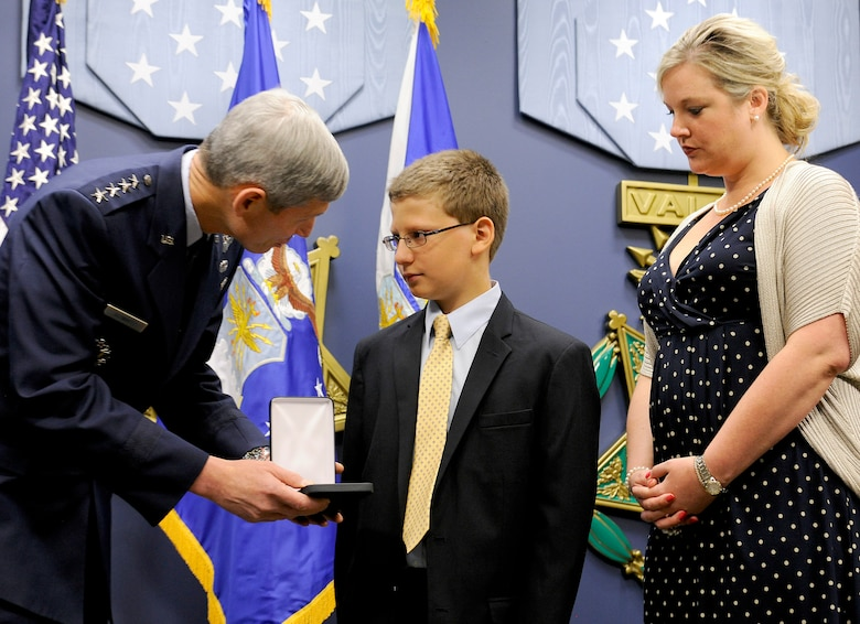 """Air Force Chief of Staff Gen. Norton Schwartz presents the Silver Star, posthumously awarded to Capt. Francis Gary Powers, to the captain's grandchildren, Francis Gary """"Trey"""" Powers III and Lindsey Barry, on June 15, 2012, in the Pentagon. Captain Powers was shot down over the Soviet Union on May 1, 1960, and received the decoration for the heroism he displayed while held prisoner by the Soviets. He was released in 1962 but subsequently died in a 1977 helicopter crash. (U.S. Air Force photo/Scott M. Ash)"""
