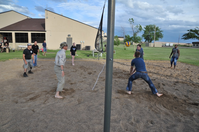 Members of the American300 Baja 1000 Tour participate in a game of volleyball with Malmstrom Airmen at the Detour June 12. The tour members enjoyed a pizza dinner while interacting with the Airmen at the facility specifically designed for their use. (U.S. Air Force photo/John Turner)