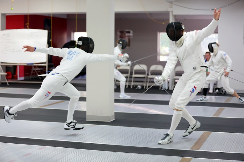 COLORADO SPRINGS, Colo. – Weston Kelsey, an Air Force captain with the 310th Force Support Squadron, right, fences U.S. Olympic Training Center teammate, Jimmy Moody, June 8, 2012. Kelsey, former U.S. Air Force Academy fencer and now three-time Olympian, has been fencing for approximately 20 years. (U.S. Air Force photo by Staff Sgt. Kathrine McDowell)