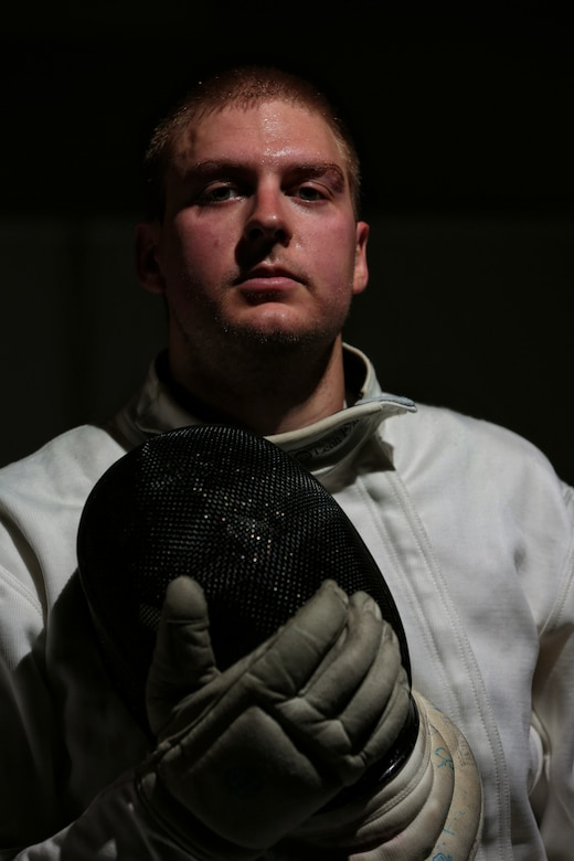 COLORADO SPRINGS, Colo. –Weston Kelsey, 310th Force Support Squadron supply officer, poses with his fencing mask at the U.S. Olympic Training Center June 8, 2012. Kelsey, 2011 U.S. Air Force Male Athlete of the Year, helped the U.S. Men's Epee Team defeat the six-time reigning World Champion French team to become the first U.S. Men's Fencing Team to win gold at the World Team Championships. (U.S. Air Force photo by Staff Sgt. Kathrine McDowell)