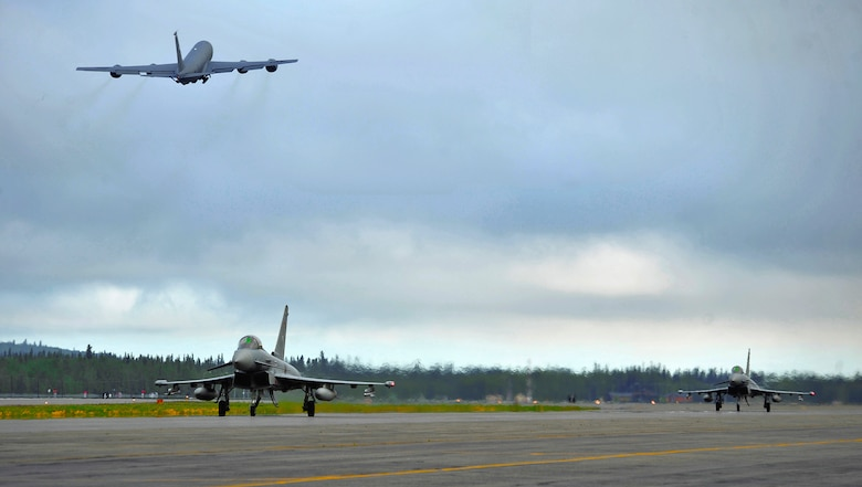 Two German air force Eurofighter Typhoons taxi the runway as a KC-135R Stratotanker launches from the runway during RED FLAG-Alaska 12-2 June 11, 2012, Eielson Air Force Base, Alaska.  This is the first time the Typhoon has participated in RF-A.  The KC-135R Stratotanker is assigned to the 22nd Air Refueling Wing, McConnell Air Force Base, Kan.  (U.S. Air Force photo/Staff Sgt. Miguel Lara III)