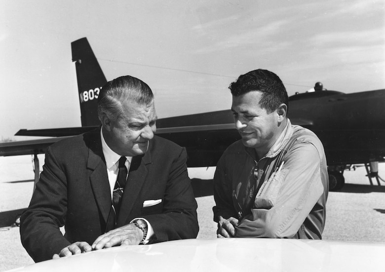 Francis Gary Powers (right) talks to U-2 designer Kelly Johnson in 1966. Powers was an Air Force fighter pilot recruited by the CIA in 1956 to fly civilian U-2 missions deep into Russia. Powers and other Air Force Reserve pilots resigned their commissions to become civilians. (U.S. Air Force photo)