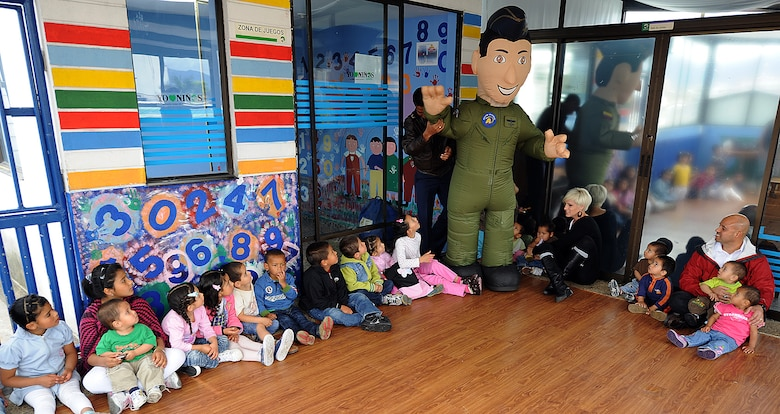 """Colombian air force mascot """"Capitan Paz"""" made a special guest appearance to the nearly 30 children at Asociación Amigos del Niño Ayudame. Bogota, Colombia June 9.  Members of the Colombian air force and the 571st Mobility Support Advisory Squadron visited the orphanage as part of an Air Mobility Command Building Partner Capacity month-long mission. Airmen from both the Inter-American Air Forces Academy and 12th Air Force (Air Forces Southern) also participated in the visit.  (U.S. Air Force photo by Tech. Sgt. Lesley Waters)"""