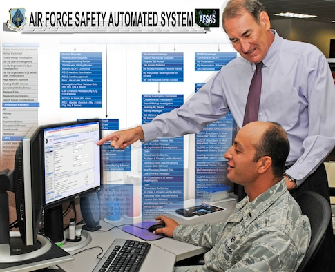 Mike Collins, deputy chief, Air Force Safety Center Analysis and Integration Division, demonstrates the the features of the Air Force Safety Automated System to 1st Lt. Brian Raphael.  AFSAS is a single integrated mishap reporting tool that provides mishap information and timely risk mitigation data to all levels of command throughout the Air Force. (Graphic by Keith Wright)