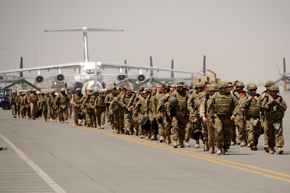Personnel from McEntire Joint National Guard Base, S.C., arrive at Kandahar Airfield, Afghanistan, June 10, 2012, to begin the second half of the unit's Air Expeditionary Force rotation in country. Members of the 169th Fighter Wing are deployed in support of Operation Enduring Freedom. Swamp Fox F-16's, pilots, and support personnel began their AEF deployment early April to take over flying missions for the air tasking order and provide close air support for troops on the ground in Afghanistan.