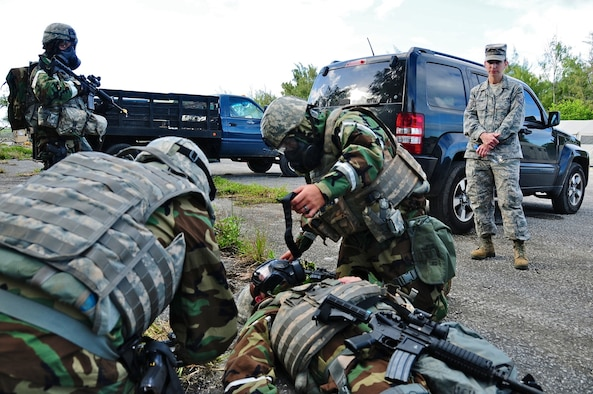 The 36th Contingency Response Group Airmen perform self aid and buddy care on a simulated unconscious Airman after a chemical attack scenario during an exercise at Northwest field, Guam, June 6. The 36 CRG conducted a four-day exercise in order to hone their tactical skills, improve operational readiness and prepare for an upcoming unit compliance inspection. (U.S. Air Force photo by Airman 1st Class Marianique Santos/Released)