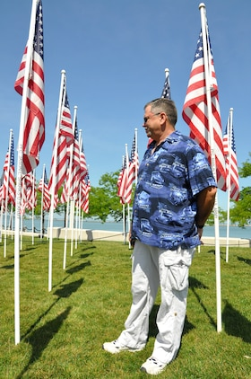 Dennis Roberts, a Cleveland native, mourns for his nephew, Army Pfc. Jason L. Sparks, at the Ohio Flags of Honor in Voinovich Park in Cleveland June 15 during Marine Week Cleveland which ends June 17. Various  displays showcasing Marine Corps equipment, aircraft and technology are available for viewing at Gateway Plaza and Voinovich Park. More than 750 Marines are participating in Marine Week to commemorate the city's support for the military and celebrate community, country and Corps.
