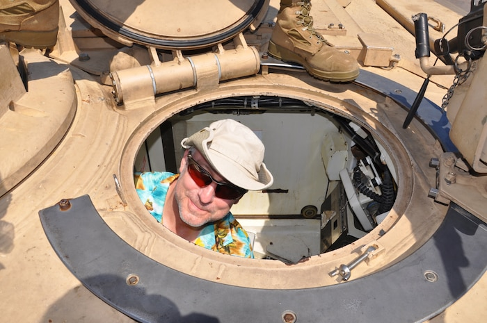 George Rasch, a Cleveland native, explores a M1-A1 Abrams tank in Voinovich Park in Cleveland June 15 during Marine Week Cleveland which ends June 17. Various displays showcasing Marine Corps equipment, aircraft and technology are available for viewing at Gateway Plaza and Voinovich Park. More than 750 Marines are participating in Marine Week to commemorate the city's support for the military and celebrate community, country and Corps.