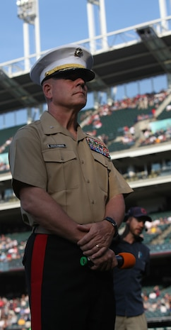 Brig. Gen. Joseph L. Osterman, the commanding general of Marine Corps Recruiting Command, prepares to lead soon-to-be Marine recruits in the oath of enlistment during Marine Night before the Cleveland Indians took on the Pittsburgh Pirates at Progressive Field June 15, during Marine Week Cleveland, which ends June 17. After the oath, the Marine Corps Base Quantico Band played v'˜America the Beautiful,v'