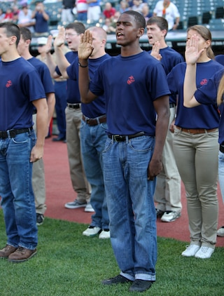 Aaron Johnson, a poolee with Recruiting Sub-Station Maple Heights, takes the oath of enlistment with fellow greater Cleveland area poolees during Marine Night before the Cleveland Indians took on the Pittsburgh Pirates at Progressive Field June 15, during Marine Week Cleveland, which ends June 17. Brig. Gen. Joseph L. Osterman, Marine Corps Recruiting Command commanding general, swore in the soon-to-be Marine recruits. Then the Marine Corps Base Quantico Band performed, the Holy Angels Church Choir sang the National Anthem and Sgt. Maj. of the Marine Corps Micheal P. Barrett threw the first pitch of the game.
