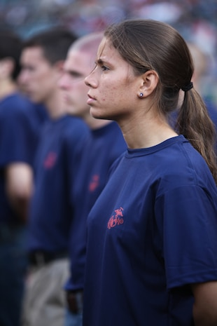 Brittany Grooms, a poolee with Recruiting Sub-Station Lakewood, stands at attention during Marine Night before the Cleveland Indians took on the Pittsburgh Pirates at Progressive Field June 15, during Marine Week Cleveland, which ends June 17. Brig. Gen. Joseph L. Osterman, Marine Corps Recruiting Command commanding general, swore in the soon-to-be Marine recruits. Then the Marine Corps Base Quantico Band performed, the Holy Angels Church Choir sang the National Anthem and Sgt. Maj. of the Marine Corps Micheal P. Barrett threw the first pitch of the game.