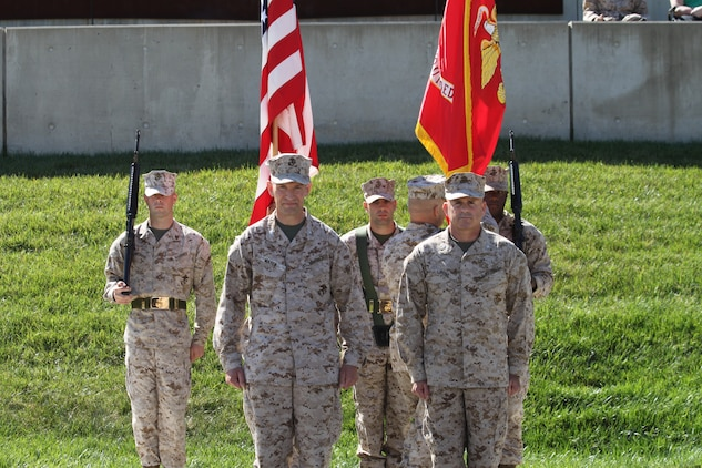 Col. John L. Mayer (left) and Col. Willard A. Buhl (right) stand prepared to conduct the ceremonial passing of the unit colors during a change of command ceremony for the Wounded Warrior Regiment at the National Museum of the Marine Corps here.  Mayer, the outgoing commanding officer, will move on to serve as the chief of staff for amphibious operations for the 1st Division Royal Australian Army.