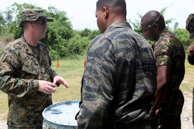 CHRIST CHURCH, Barbados —U.S. Marine Staff Sgt. Joseph Neil, Headquarters Company, 23rd Marine Regiment, 4th Marine Division, and a Brockton, Mass., native briefs law enforcement and defense personnel from partner nations before a fire and maneuver drill at Barbados Defense Force Paragon, Christ Church, Barbados, June 16, 2012, during Exercise Tradewinds 2012.  Tradewinds is a CJCS-approved, USSOUTHCOM-sponsored exercise supporting the Theater Security Cooperation (TSC) plan, and involving security forces from 17 partner nations (PN),primarily from the Caribbean Basin AOR and will also include participants from Canada and the U.S. (U.S. Marine Corps photo by Cpl. Nana Dannsa-Appiah/Released)