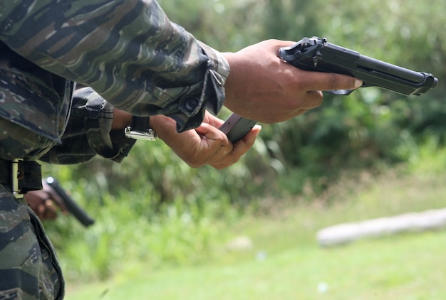 CHRIST CHURCH, Barbados —A law enforcement official from a partner nation loads a magazine into his pistol at Barbados Defense Force Paragon, Christ Church, Barbados, June 16, 2012, during Exercise Tradewinds 2012.  Tradewinds is a CJCS-approved, USSOUTHCOM-sponsored exercise supporting the Theater Security Cooperation (TSC) plan, and involving security forces from 17 partner nations (PN),primarily from the Caribbean Basin AOR and will also include participants from Canada and the U.S. (U.S. Marine Corps photo by Cpl. Nana Dannsa-Appiah/Released)