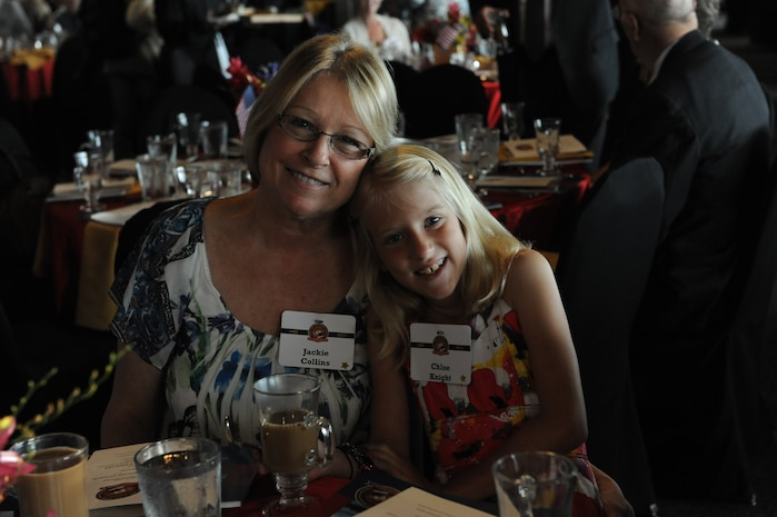 Chloe Knight with her grandmother Jackie Collins attending the Marine Week Cleveland Gold Star Family brunch hosted by the Marine Corps Scholarship Foundation at Legends Club in Cleveland Browns Stadium June 17, 2012. Knight's father, Cpl. Timothy A. Knight, was killed in Iraq. The Marine Corps Scholarship Foundation, which is celebrating its 50th anniversary, provides scholarships to the children of Marines and Navy corpsmen, with special focus on those with a parent killed or wounded in combat.  Marine Week Cleveland, which showcased the Marine Corps' capabilities and community ties, ended June 17.