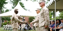 Sergeant Major Michael Jones assumes duty as the U.S. Marine Corps Forces Command sergeant major during the traditional passing of the non-commissioned officer sword at the unit's relief and appointment ceremony, June 14. The passing of the sword symbolizes the transfer of responsibility, knowledge and leadership to the new sergeant major for a unit.