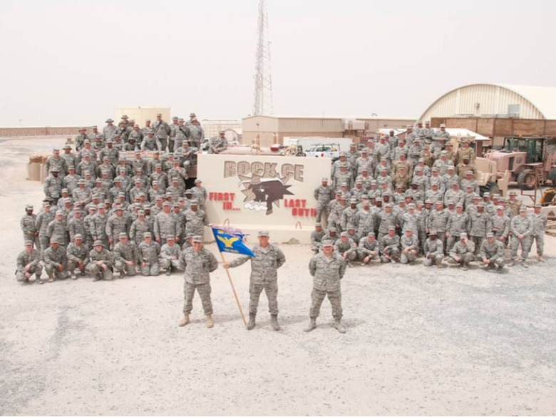 SOUTHWEST ASIA -- Air guardsmen from the 176 Civil Engineer Squadron stand along side the other members of the 386 Air Expeditionaly Wing in formation here May 5. The air guardsmen were assigned to the 386 Expeditionary Civil Engineer Squadron for a six-month tour.
