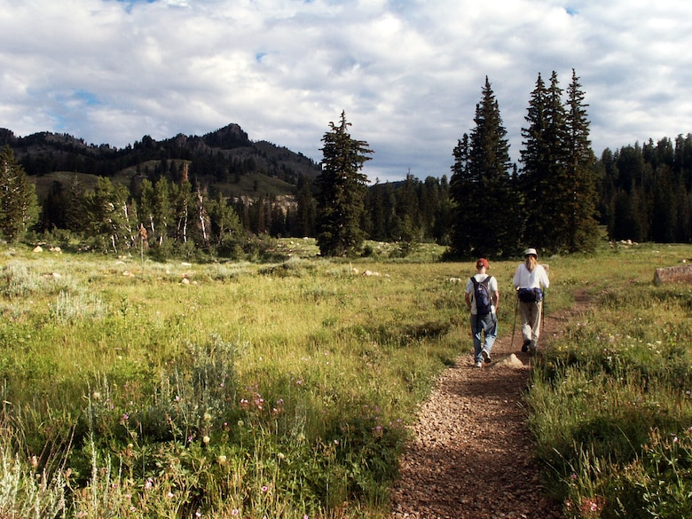 Cory Warburton and Jette Carr hike on a trail near Beaver Mountain Ski Resort, Utah, summer of 2003.  The hike was part of a trek spanning from the bottom to the top of Utah to each boarder – a journey that took 43 days and was nearly 700 miles long.  (Courtesy photo)
