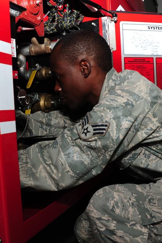 U.S. Air Force Senior Airman Anthony Burdett, 628th Logistics Readiness Squadron vehicle maintenance mechanic, checks batteries on a fire truck at Joint Base Charleston, S.C., June 13, 2012. Technical school training for vehicle maintenance mechanic's is 18-weeks long at Port Hueneme Naval Base, Calif. (U.S. Air Force photo/ Airman 1st Class Chacarra Walker)