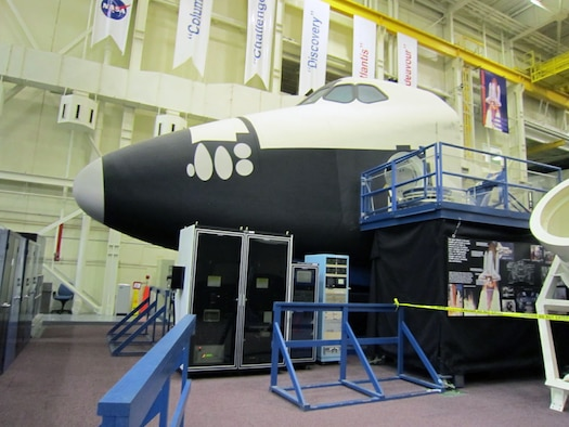 The Crew Compartment Trainer (CCT) is a high-fidelity representation of the orbiter crew station that was used primarily for on-orbit crew training and engineering evaluations. Here, astronauts learned how to operate many of the orbiter sub-systems in more than 20 different classes. (U.S. Air Force photo)