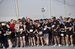 KANDAHAR AIRFIELD, Afghanistan — Runners from all over Kandahar Airfield await the start of the Engineer Day 5-kilometer run, June 16, 2012. Runner number 376, Royal Air Force Sgt. Paul Vernon (left front), was the first place finisher. The first place female runner was a U.S. Army runner 2nd Lt. Jennifer Han who works at the KAF medical center.