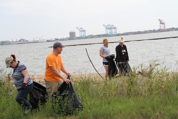 PORTSMOUTH, Va. -- More than 23 employees and family members from the Norfolk District participated in Clean the Bay Day June 2, 2012. Clean the Bay Day is a statewide initiative organized by the Chesapeake Bay Foundation, in conjunction with municipalities, businesses and government agencies working together to restore the Chesapeake Bay and its rivers and streams. Every year since 1989, thousands of citizens throughout the Commonwealth of Virginia have dedicated their time to clear litter from waterways. Norfolk District employees volunteered three hours of their time today to remove debris from the shorelines of the Craney Island Dredged Material Management Area, which is operated and maintained by the district. CIDMMA is a 2,500-acre confined dredged material disposal site on the north side of Portsmouth, Va. It serves as an economical and environmentally sustainable repository for material dredged within the federal waterways of the Hampton Roads harbor.