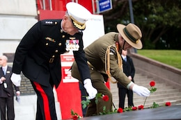 WELLINGTON, New Zealand - Lt. Gen. Duane D. Theissen (left), commander of U.S. Marine Corps Forces, Pacific, and Lt. Gen. Rhys Jones, New Zealand chief of defense force, place roses on the tomb of the unknown warrior at the National War Memorial here June 14. Theissen, along with Maj. Gen. Ronald Bailey, commander of 1st Marine Division, were present at the wreath-laying ceremony to commemorate the 70th anniversary of U.S. Marines landing in Wellington during World War II. (U.S. Marine Corps photo by: Cpl. Isis Ramirez/released)