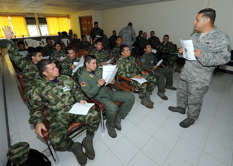 Technical Sgt. Melvin Rosario, Inter-American Air Forces Academy instructor, goes over the maintenance operations center hand out during the first day of MOC seminars June 12, at Comando Aéreo de Combate No. 1 base, Palanquero, Colombia, as part of a month-long Air Mobility Command Building Partner Capacity mission. (U.S. Air Force photo by Tech. Sgt. Lesley Waters)