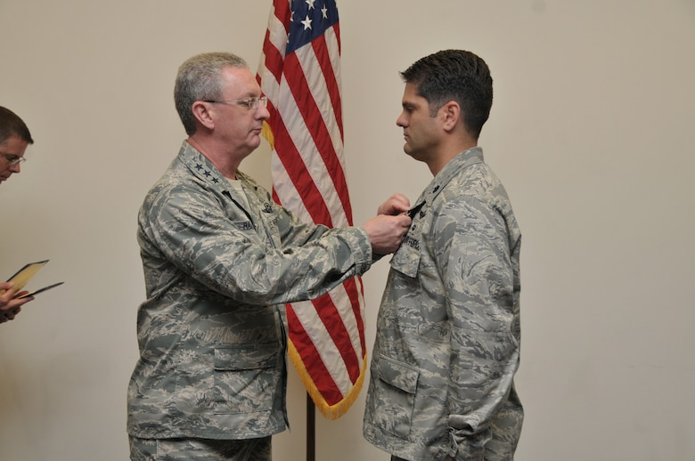 Lt. Col. Douglas Edwards (right), 906th Air Refueling Squadron Commander, receives the Airman's Medal from Lt. Gen. Mark Ramsay, 18th Air Force Commander, in a ceremony at Scott AFB, IL on May 21, 2012.  Edwards received the award for rescuing an elderly woman from a burning vehicle on Nov. 2, 2009 near King Hill, Idaho.  With complete disregard for his own safety, Edwards succeeded in freeing the injured and trapped victim from her car just moments before the entire vehicle became engulfed in flames.  Local Sheriff Deputies responded within eight minutes of the initial 9-1-1 call about the accident and later told Edwards the victim would have been burned alive if he hadn't acted so quickly.  (U.S. Air Force photo by Master Sgt. Franklin Hayes)