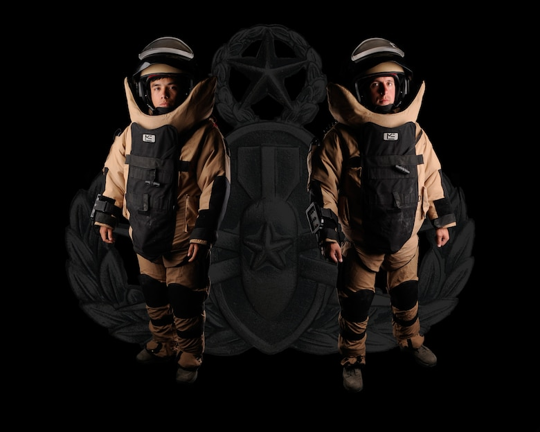 U.S. Air Force Airman 1st Class Gabriel Kalohelani, 366th Civil Engineer Squadron explosive ordnance disposal apprentice, and Staff Sgt. Jonathan Winter, 366th CES EOD journeyman, display the EOD-9 Bomb Suit, June 14, 2012, at Mountain Home Air Force Base, Idaho, after being a part of a Presidential detail which helps ensure the area around the president is free of explosive ordnance. Winter and Kalohelani have worked the presidential detail together and coincidentally it was the seventh time for each Airman individually. (U.S. Air Force photo illustration/ Airman 1st Class Jonathan Glanville)