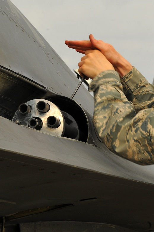 SPANGDAHLEM AIR BASE, Germany – Senior Airman Stephen Hoffler, 480th Aircraft Maintenance Unit weapons load crew member, puts a panel back onto an F-16 Fighting Falcon during mandatory 30 day gun-load maintenance on Ramp 4 here June 19. The 480th AMU plays a vital role in supporting the F-16's combat training mission, which prepares pilots for regional defense and air superiority. (U.S. Air Force photo by Airman 1st Class Dillon/Released)
