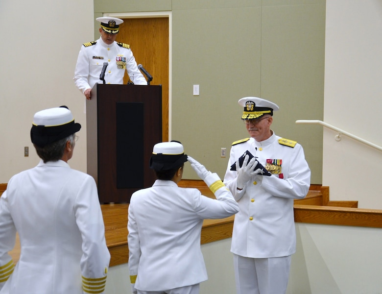 Joint Base San Antonio-Fort Sam Houston, Texas,  Rear Adm. Eleanor Valentin, Commander, Navy Medicine Support Command and Director, Navy Medical Service Corps renders a salute after presenting the flag to Rear Adm. Bob Kiser during his retirement ceremony June 15. Kiser, the first commandant of the Medical Education and Training Campus, retired after 38 years of combined reserve and active duty service. (U.S. Navy photo by Lisa Braun/released)