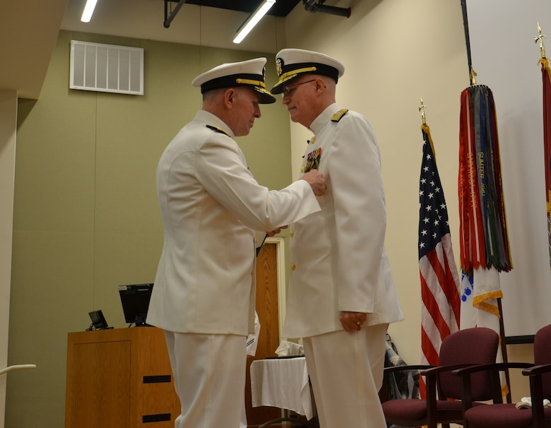 Joint Base San Antonio-Fort Sam Houston, Texas,  Vice Adm. Matthew Nathan, surgeon general of the Navy, and Bureau of Medicine and Surgery chief, awards the Legion of Merit to Rear Adm. Bob Kiser during his retirement ceremony June 15. Kiser, the first commandant of the Medical Education and Training Campus, retired after 38 years of combined reserve and active duty service. (U.S. Navy photo by Lisa Braun/released)