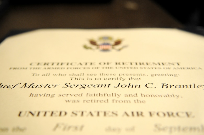 Chief Master Sgt. John Brantley's retirement certificate was presented to him during an official ceremony May 18, 2012, at Barksdale Air Force Base, La. From humble beginnings in Dublin, Ga., he rose to the top enlisted rank after only 21 years in service with a dedicated work ethic that led him to win many annual awards at the Airman, NCO and senior NCO levels. (U.S. Air Force photo/Senior Airman Brigitte N. Brantley)