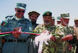 Afghanistan National Police, civic and provincial leaders recently commemorate the transfer of the Border Police Zone Command station at Gardez in Paktya Province with a ribbon-cutting ceremony.