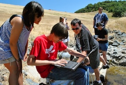 UKIAH, Calif. -- Members of the Vallejo High School robotics team in California, The Zombots, look at images transmitted by a robot they built. The team brought their robot, named Charles, to the Coyote Dam here to assess the interior conditions of a pipe that runs along the dam.