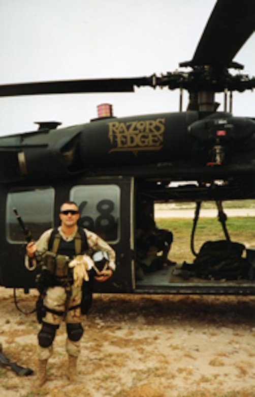 """Retired Air Force Master Sgt. Scott Fales stands in front of """"Super 6-8."""" Courtesy Photo"""