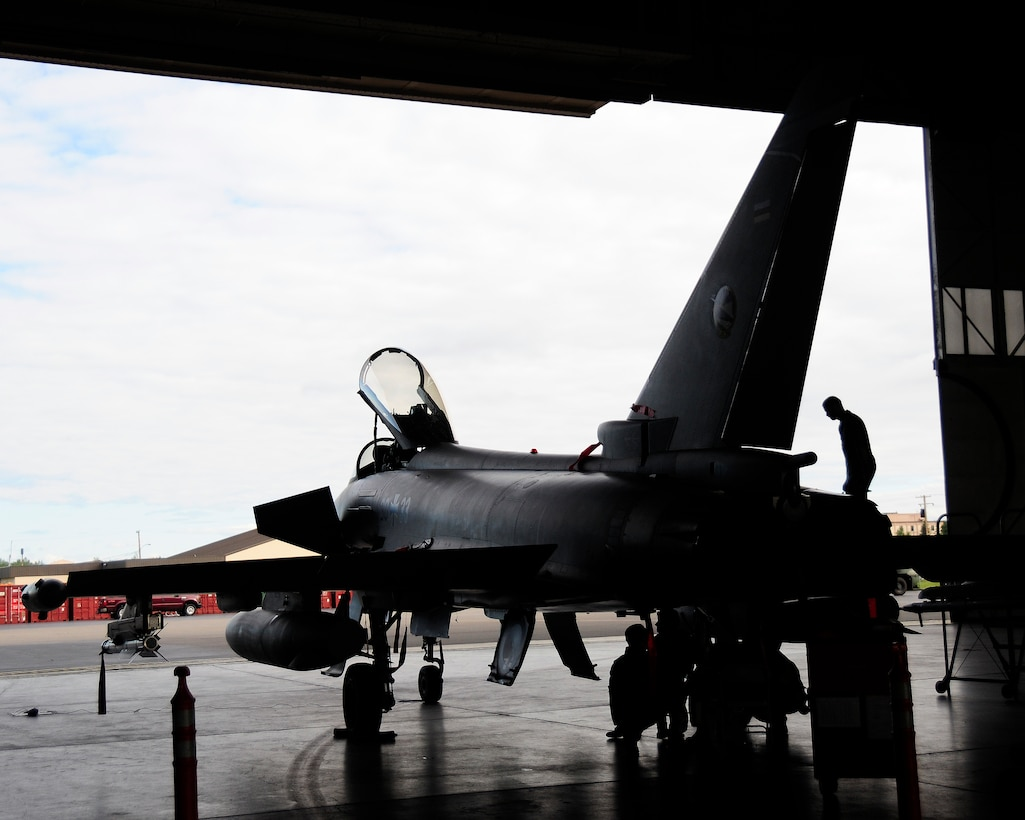 German air force maintainers inspect a German Eurofighter Typhoon upon its return from a flight during RED FLAG-Alaska 12-2, Eielson Air Force Base, Alaska. This is the first time the German Eurofighter has participated in a RF-A, as well as its first time on U.S. soil. (U.S. Air Force photo/Airman 1st Class Zachary Perras)