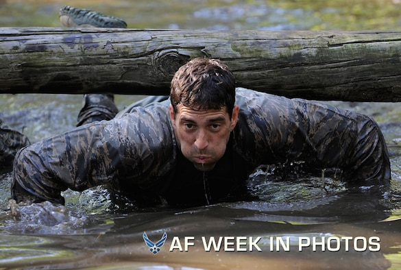 Maj. Christopher Wright navigates through a water obstacle during a combat mission readiness evaluation the Pre-Ranger Course at Fort Bragg, N.C., June 14, 2012. Wright is the director of operations of the 14th Air Support Operations Squadron at Pope Field, N.C. (U.S. Air Force photo/Val Gempis)
