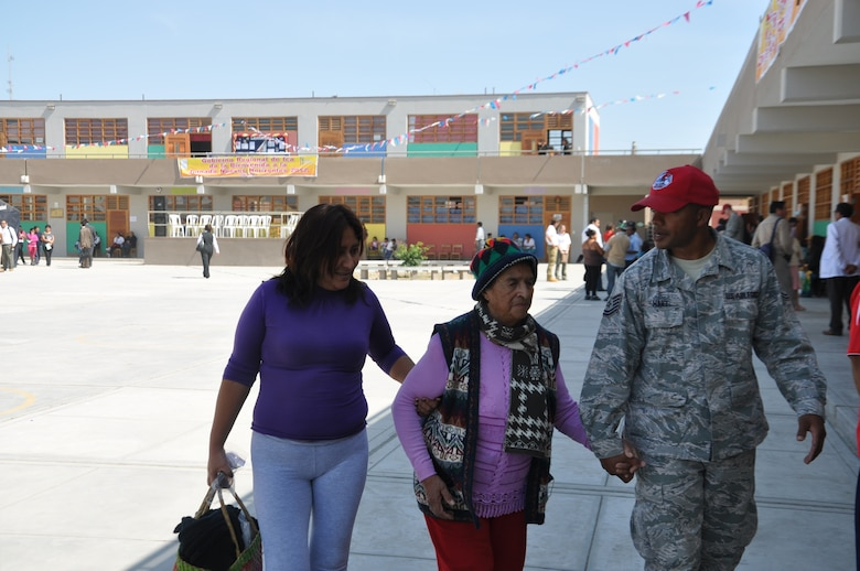 SAN CLEMENTE, Peru—Tech. Sgt. Adanzy Hart escorts a Peruvian woman to see an Air Force doctor at a free medical clinic offered as part of New Horizons Peru 2012. The U.S. Southern Command-sponsored New Horizons exercise offers U.S. and Peruvian military medical personnel to train and work together while providing free medical services to about 30,000 Peruvians over the coming two months.  Sergeant Hart has been assisting with medical translation and is deployed from the 820th Red Horse Squadron, Hurlburt Field, Fla. (U.S. Air Force photo by: Capt. Candace N. Park/released)