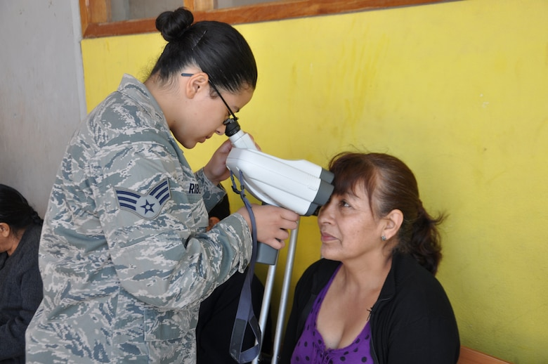 SAN CLEMENTE, Peru—Senior Airman Ericka Ribeiro checks the eyes of a local Peruvian woman attending the New Horizons medical readiness and training exercise here June 19. During New Horizons Peru, Air Force and Army medical personnel are training side-by-side with their Peruvian military counterparts while providing needed medical services to nearly 30,000 Peruvians. New Horizons is a U.S. Southern Command-sponsored annual joint and combined training exercise and humanitarian assistance events in Latin American and Caribbean nations. Airman Ribeiro is deployed to Peru from the 87th Aeromedical Dental Squadron from Joint Base McGuire-Dix-Lakehurst, N.J.   (U.S. Air Force photo by: Capt. Candace N. Park/released)