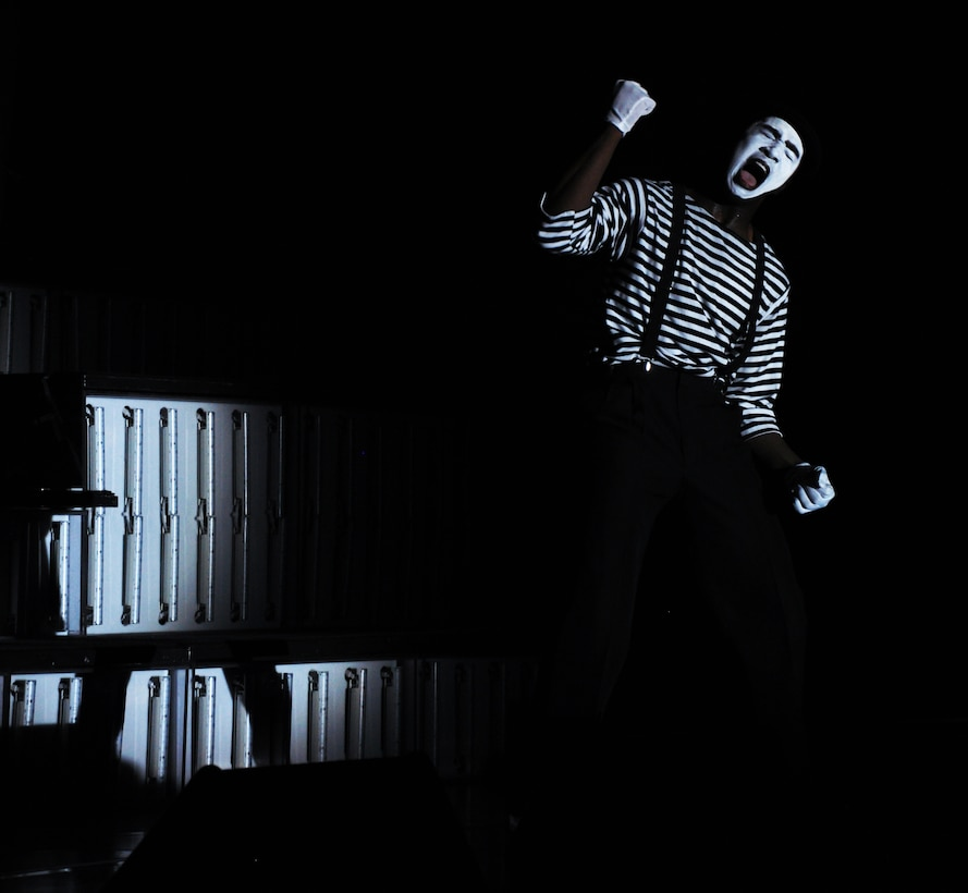 A member of Tops in Blue performs a mime routine during a show at Beale Air Force Base, Calif., June 16, 2012. TIB perform approximately 130 shows yearly for military personnel and their families.  (U.S. Air Force photo by Staff Sgt. Robert M. Trujillo/Released)