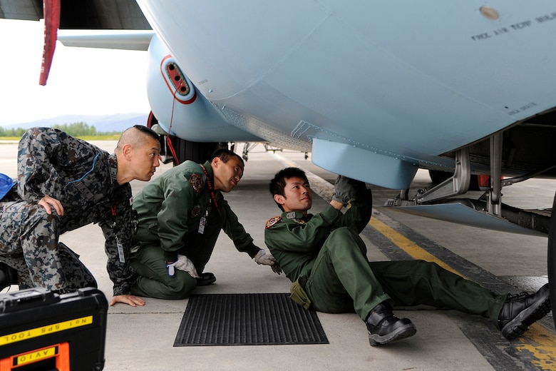 Members of the Japanese Air Self Defense Force work on a Japanese C-130 Hercules during Red Flag - Alaska on the flight line of Joint Base Elmendorf-Richardson, Alaska June 19. The C-130 Hercules offers a maximum speed of 600 kilometers an hour with a payload of 19,400 pounds and can be used for air drops. Red-Flag Alaska is designed to strengthen bilateral ties between nations and offers the JASDF the opportunity to improve aerial tactics. (U.S. Air Force photo/Staff Sgt. Zachary Wolf)