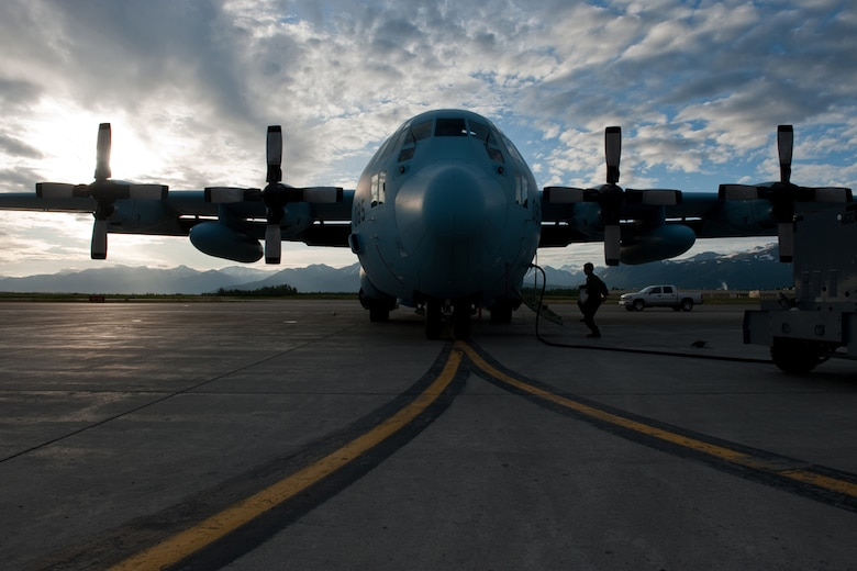 A member of the Japanese Air Self Defense Force performs pre-flight inspections while the Japanese C-130 Hercules recharges during Red Flag - Alaska on the flight line of Joint Base Elmendorf-Richardson, Alaska June 19. The C-130 Hercules offers a maximum speed of 600 kilometers an hour with a payload of 19,400 pounds and can be used for air drops. Red-Flag Alaska is designed to strengthen bilateral ties between nations and offers the JASDF the opportunity to improve aerial tactics. (U.S. Air Force photo/Staff Sgt. Robert Barnett)