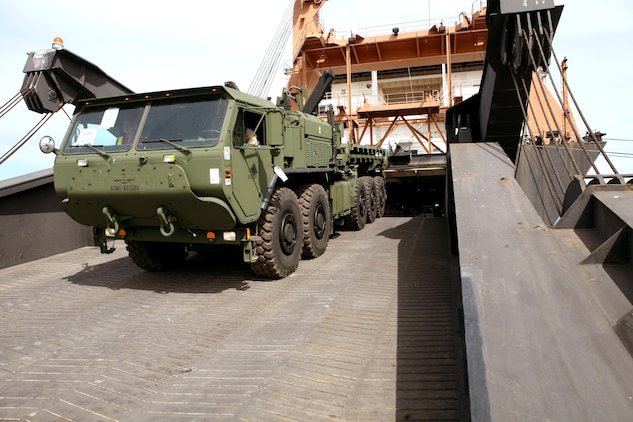 A Marine assigned to Combat Landing Brigade-13 drives a Logistic Vehicle System Replacement (LVSR) down the ramp of the USNS Sgt Matej Kocak during an off-load/cross-leveling operation to retrograde equipment into the caves, belonging to the Marine Corps Prepositioning Program-Norway.  During this operation more than 150 vehicles and 200 shipping containers were transferred on or off the Kocak and staged for transportation to the caves or loaded back onto the ship. The MCPP-N facility is comprised of seven locations totaling more than 900,000 square feet of storage space. The actual caves total 471,445 sq. ft. of climate controlled storage space, regulated to  between 45 to 55 percent humidity and a regulated temperature of between 45 to 50 degrees. This precise regulation allow for tents, vehicle tires and parts and other climate sensitive equipment to be stored safely, and maintain a high level of accessibility to be readily deployable for any contingency that may arise.