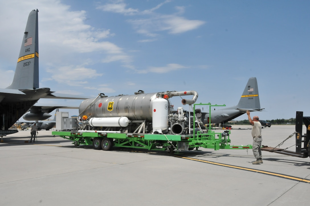 Members of the 153rd Airlift Wing, Cheyenne, Wyo., prepare to load a U.S. Forest Service Modular Airborne Firefighting System II onto a Wyoming Air National Guard C-130, June 24, 2012. The Wyoming Air National Guard MAFFS unit has been activated to support the Rocky Mountain area fires, they will base out of Colorado Springs, Colo. (U.S. Air Force photo by Staff Sgt. Natalie Stanley)